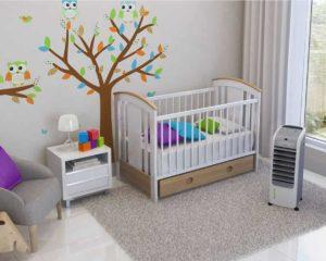 um climatizador de ar ventsol em quarto com cama infantil