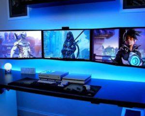 monitores gamers com consoles no quarto de jogo na casa
