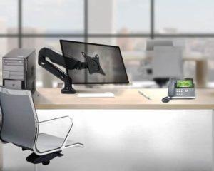 um monitor e suporte para monitor em office